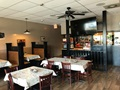 Profitable Pizza Restaurant With Ample Seating & Strong 'to Go' Business Located In Large Strip Mall